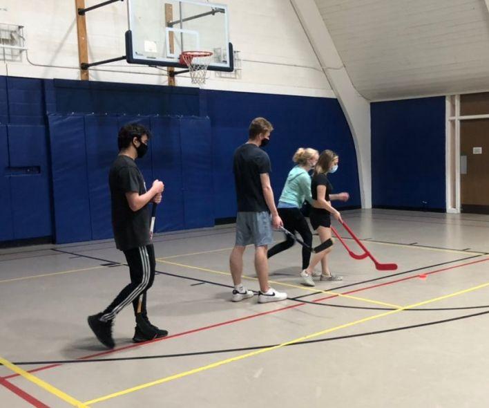 High school fitness class floor hockey